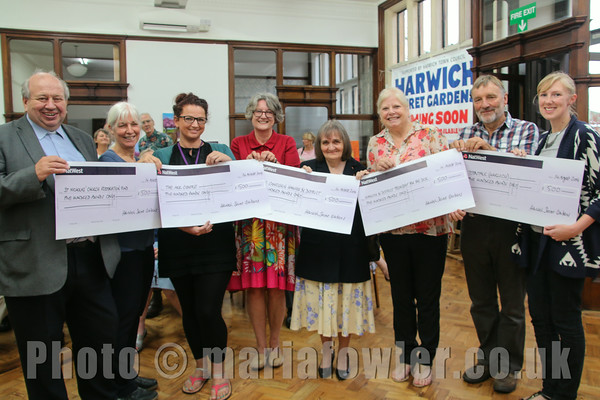 Thursday 14th August 2014. Harwich Secret Gardens Cheque Presentation evening at Old Bank Studios, Harwich.Pictured L-R: Rev Peter Mann (St. Nicholas' Church) Jackie Denton (HSG), Claire Hyams-Morgan (The Ark centre) Deborah Rich (HSG), Dorothy Cole (Age Concern), Judith Skargon (Fellowship for the Sick), Martin Evans (HSG) and Emma Blaber  (Teentalk).