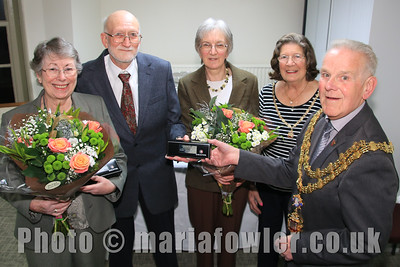 "Press Release Recognition for 10 years joint service to Harwich's historic archive. A Mayor's reception was held at Harwich's Guildhall last night to officially open Harwich Town Council's new archive centre and to recognise 10 years of joint service by the council's honorary archivists, Ray Plummer and Anne Kemp-Luck.The project to convert the top storey of the Guildhall into a new archive centre was recently completed and the moving of the archive into its new home coincided with the 10th anniversary of Ray Plummer joining Anne Kemp-Luck as the custodians of the archive. Mayor of Harwich, Cllr Alan Todd, says, ""Ray and Anne's knowledge, expertise and dedication are truly remarkable and we are extremely fortunate to have them looking after one of Harwich's greatest assets.  As we seek to use our history to promote 'Historic Harwich' the many centuries of documents that make up the archive are more important than ever.""Ray and Anne were presented with gifts in recognition of their service at the reception held in the new archive centre. ""The council was delighted to recognise Ray and Anne's service and very pleased that they now have a spacious and more fitting environment to carry out their important work,"" continued Cllr Todd.  ""The documents that prove why Harwich is truly 'Historic' are in very good hands."" For further information please contact Lucy Ballard, Clerk to the Council, on 01255 507211Photo © Maria Fowler 2015"
